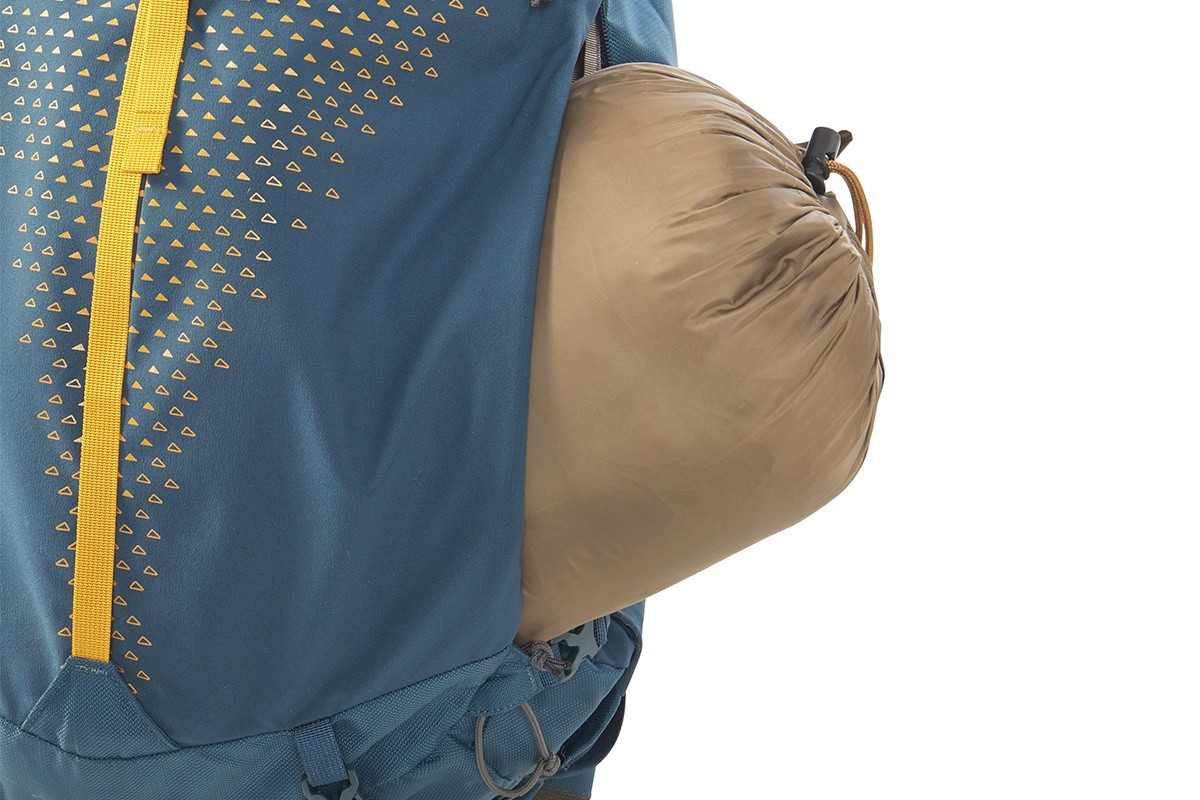 Close up of Kelty Zyp 38 backpack, showing sleeping bag partially extending out of side zipper