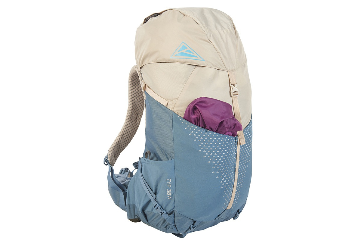 Kelty Women's Zyp 38, Sand, with purple jacket stored inside front pocket