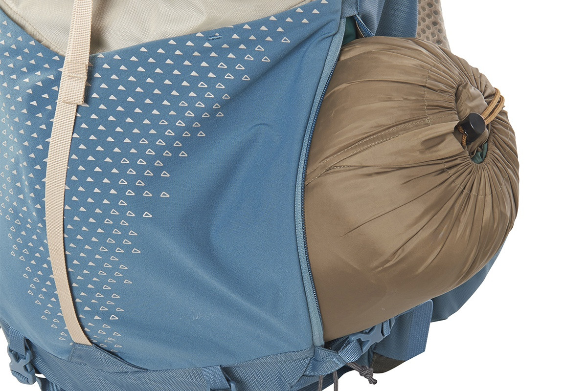 Close up of Kelty Women's Zyp 38, showing bottom unzipped and sleeping bag partially extending out of pack