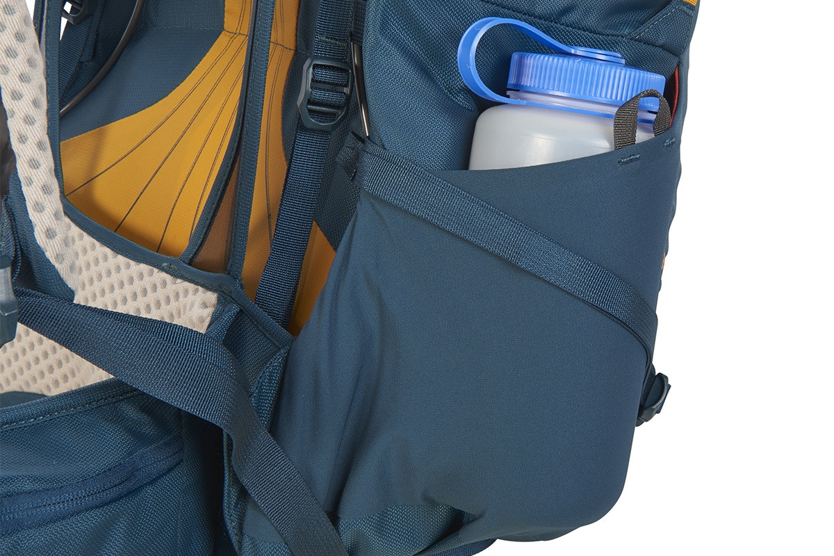 Close up of Kelty Zyp 48 backpack, showing large water bottle stored in side pocket