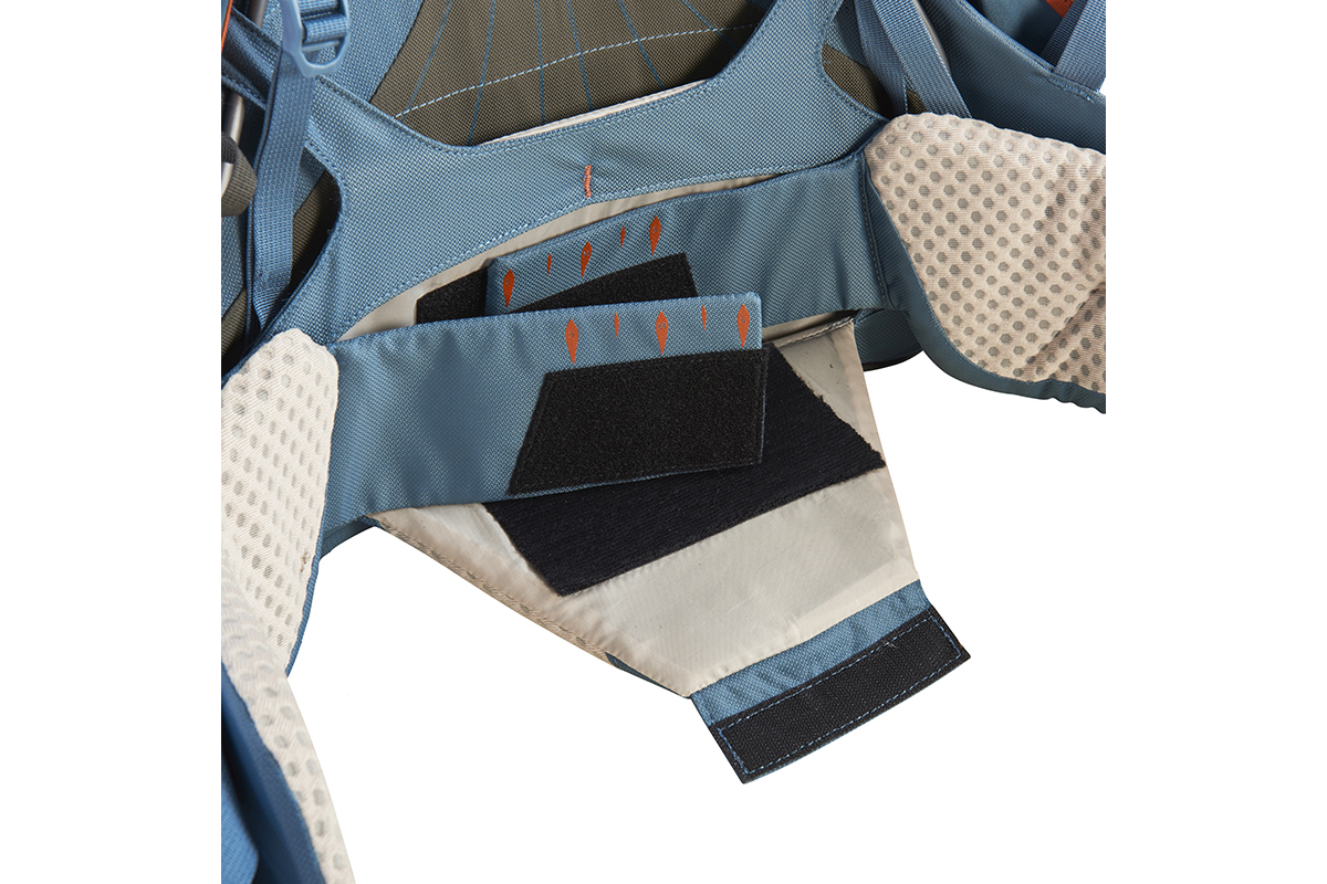 Close up of the rear of Kelty Women's Zyro 64 backpack, showing how waist belt width can be adjusted using panels of hook and loop fabric