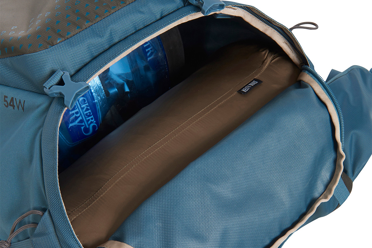 Close up of Kelty Women's Zyro 64 backpack, unzipped at bottom to show sleeping bag access