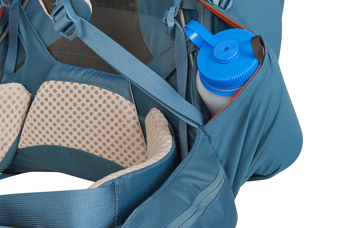 Close up of Kelty Women's Zyro 64 backpack, showing large water bottle stored inside side pocket