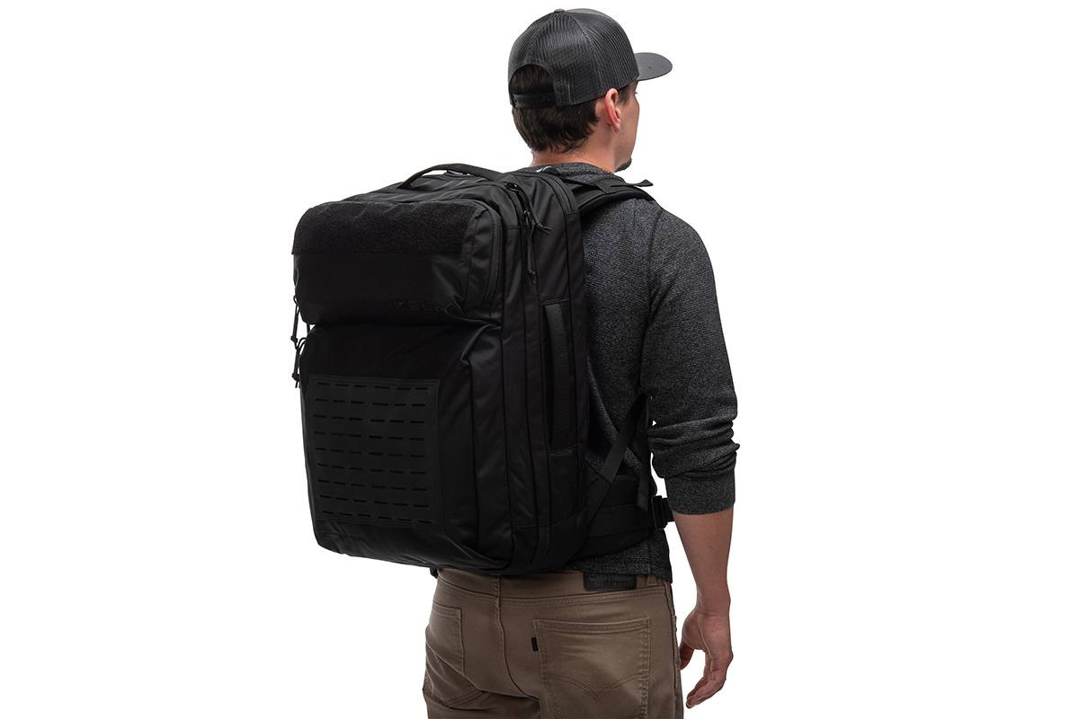 Man wearing Kelty Nomad travel pack, as seen from behind