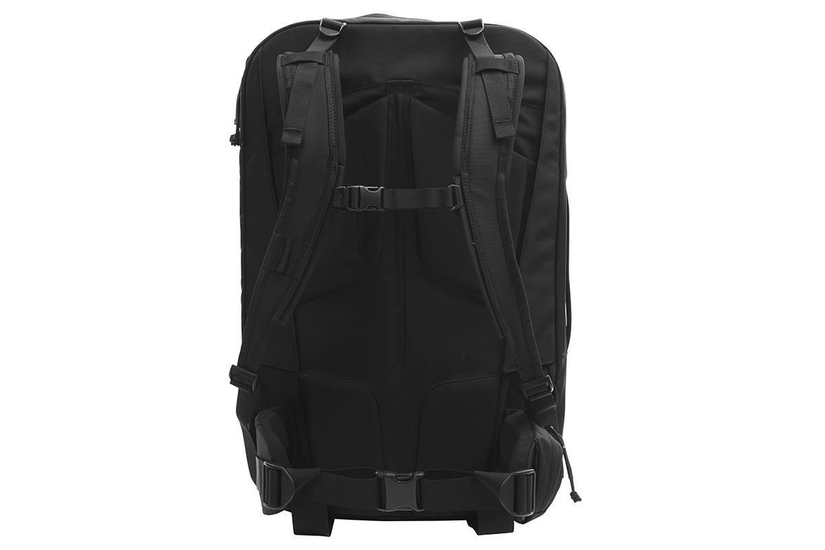 Kelty Nomad travel pack, black, rear view, showing padded shoulder straps
