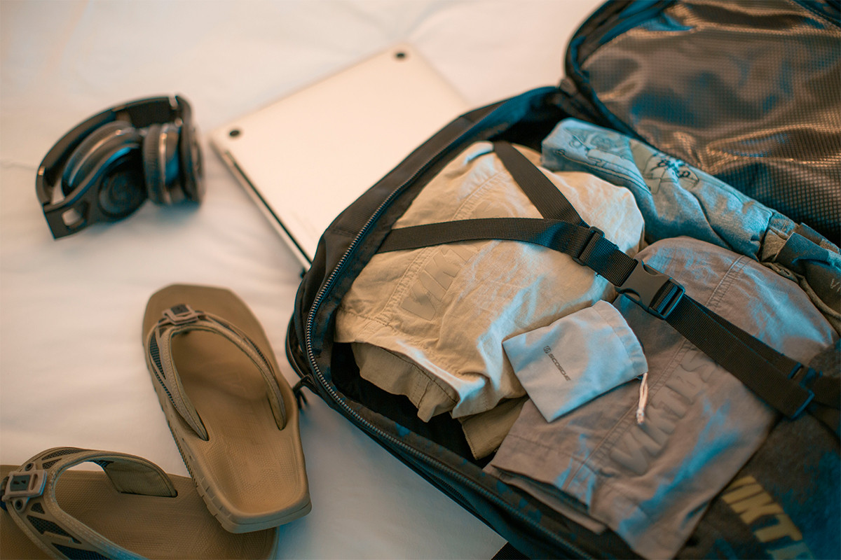 Close up of Kelty Nomad travel pack, opened to show large storage compartment with clothes