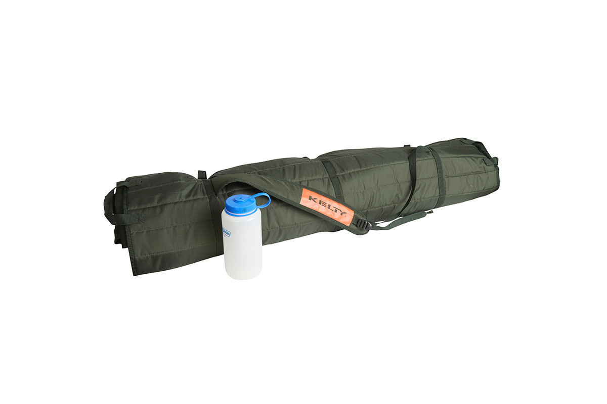 Kelty Discovery High Cot packed inside storage tote, showing carrying strap, next to 32 oz. water bottle