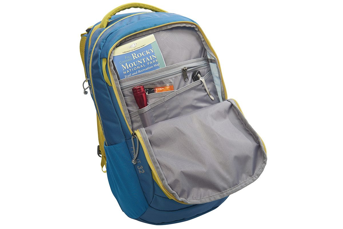 Kelty Flint 32 daypack, Lyons Blue/Warm Olive, opened to show interior organization pockets