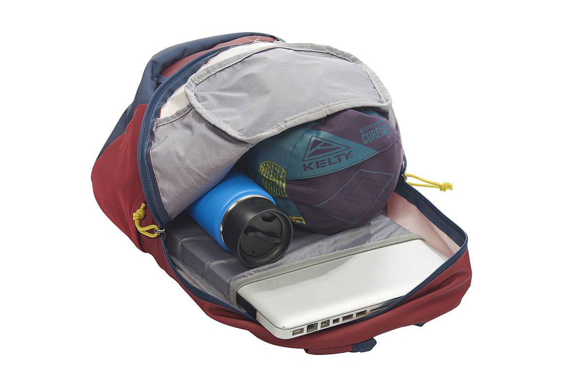 Kelty Agate 24 Daypack, Red Ochre/Midnight Navy, opened to show blanket and water bottle stored in main compartment