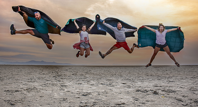 Hikers jumping for joy