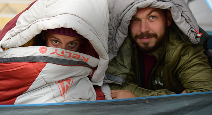 Couple goofing off in a Kelty tent