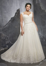 "Mori Lee 3232.  Figure Flattering A-Line Wedding Dress Featuring an Alenon Lace Appliqus on The Sweetheart Bodice and Soft Tulle Ball Gown Skirt. Delicate Cap Sleeves and a Wide Scalloped Hemline and Diamant Waistline Trim Complete the Look. Available in Three Lengths: 55"", 58"", 61"". Colors Available: White, Ivory, Ivory/Champagne."