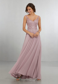 Mori Lee 21558.  Delicately Beaded Embroidery on Net over Flowing Chiffon A-Line Gown. The V-Neckline, Off-the-Shoulder Sleeves Follow Around to the Keyhole Back Neckline with Zipper. View Chiffon Swatch Card for Color Options. Shown in Desert Rose.