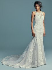 Maggie Sottero Kendall.  Classic yet striking, this fit-and-flare wedding dress features beaded lace motifs, crosshatch details, and Swarovski crystals over tulle. Lace motifs adorn the illusion halter over sweetheart neckline and illusion back. An illusion double-lace train completed the elegant romance of this look. Finished with covered buttons over zipper closure. Available in: Antique Ivory, shown, Ivory over Soft Blush.