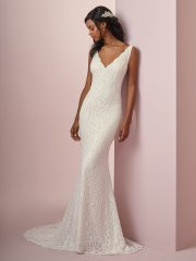 Rebecca Ingram Tina. Comprised of soft allover lace, this sheath boho wedding dress features chic straps and a V-neckline. V-back is accented with illusion and lace motifs. Lined with Inessa Jersey for an elegant fit. Finished with covered buttons over zipper closure. Available in all Ivory and Ivory over Soft Blush, shown.