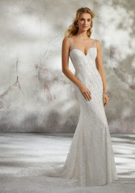 Mori Lee 8294.  Slim and Sexy, This Patterned Glitter Mesh Bridal Gown is Accented with All Over Sparkle and Pearl Details. A Deep-V Neckline and Open Back Complete the Look.  Available in: Ivory/Ivory, Ivory/Silver, and Rose Gold. Shown in Ivory/Silver.