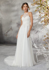 Mori Lee 5691.  Dreamy Soft English Net Wedding Dress Featuring a Diamant and Crystal Beaded and Embroidered Bodice. The Gorgeous Illusion Back is Accented with Cross-Stitch Beading and Trimmed in Covered Button Detail. Available in: White and Ivory. Shown in Ivory.