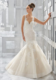 "Mori Lee 5571.  Romantic Frosted Alenon Lace Appliqus Adorn This Classic Fit and Flare Bridal Beauty. Tulle Over Sparkle Net Adds Dimension to the Skirt Finished in Horsehair Trim. Available in Three Lengths: 55"", 58"", 61"". Colors Availble: White, Ivory, Ivory/Light Gold."