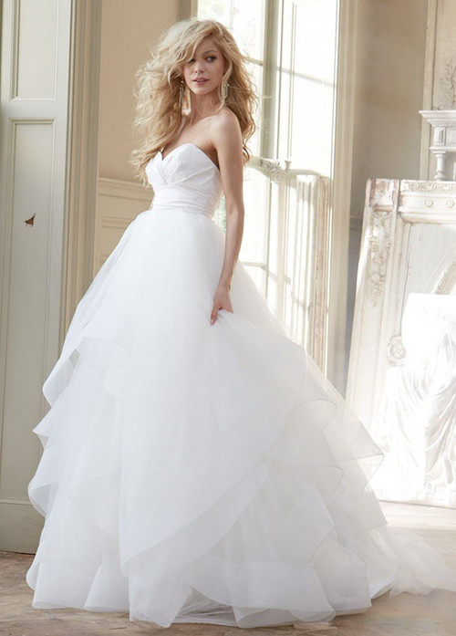 Hayley Paige 6358 Londyn.  Ivory strapless natural waist bridal ball gown with silk radzmir crossover bodice, full tulle skirt with horsehair flounces and chapel train. Shown with matching horsehair veil.