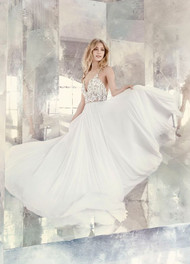 Hayley Paige 6609 Teresa.  Ivory chiffon A-line bridal gown, celestial beaded bodice with V-neckline and T-strap back, full circular chiffon skirt.