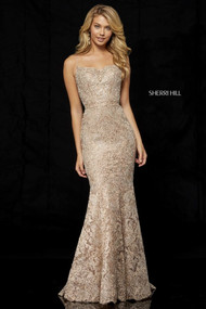 Sherri Hill 52348.  Metallic lace mermaid gown with spaghetti straps and lace up back. Available in: Rose gold/silver, Black, Silver, Gold, Blue.