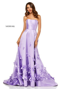 Sherri Hill 52580.  Ball Gown with Flowers Over Skirt. Available in: Lilac, Light blue, Pink, Red, Yellow, Ivory, Coral.