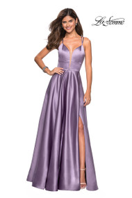 La Femme 26994.  Empire waist metallic ball gown with plunging sweetheart neckline and slit. A criss cross cut out back completes the look. Back zipper closure. Available in: Blush, Dark Berry,Deep Red, Lavender/Gray, Navy, Sapphire Blue.