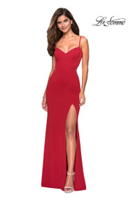 La Femme 27516.  Body forming floor length prom gown with sultry left side leg slit. Back features a multiple strap detailed design and small cut outs. Back zipper closure. Available in: Deep Red, Plum, Royal Blue.