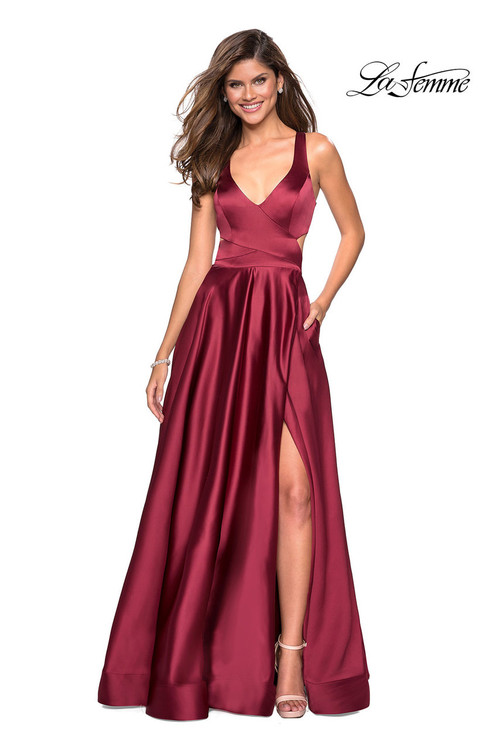 La Femme 27487.  A trendy satin floor length gown with criss cross bodice detail. Pockets, a slit, and cool double criss cross back complete this look. Back zipper closure. Available in: Deep Red, Navy.