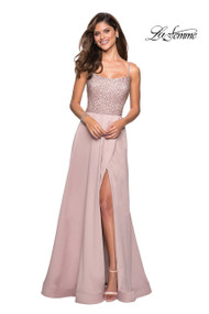 La Femme 27293.  On trend long satin dress with fully rhinestone top. Features a flowy skirt with left side leg slit and cut out back. Back zipper closure. Available in: Champagne, Lavender, Royal Blue.