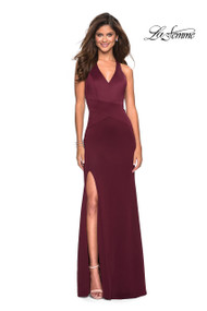 La Femme 27573.  Classic long prom dress with V shaped neckline, This jersey gown features a right side leg slit and racer back cut out design. Back zipper closure. Available in: Wine.