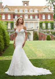 """Mori Lee 2036.  Frosted, Alenon Lace Appliqus on an Allover Chantilly Lace Mermaid with Wide Scalloped Hemline and Detachable Off-the-Shoulder Sleeves. Available in Three Lengths: 55"""", 58"""", 61"""". Detachable Off-the-Shoulder Sleeves Included. Shoulder Sleeves Also Sold Separately as Style 11303. Available in: White, Ivory, Ivory/Ros. Shown in Ivory/Ros."""