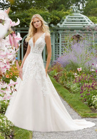 Mori Lee 2041.  Frosted, Embroidered Appliqus with Crystal Beading on a Full Tulle A-Line Gown, Accented with Diamant, Crystal, and Pearl Beaded Neckline and Waistline Trim. Detachable, Reversible Satin Front Bodice Lining Included in Matching Color and Nude. Available in: White, Ivory , Ivory/Champagne. Shown in Ivory/Champagne.