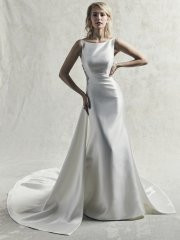 Sottero and Midgley Tyra.  Featuring elegant lines and modern details, this Keela Mikado wedding dress is perfect for a chic yet vintage-inspired look. The sheath skirt features a panel train, with Swarovski-crystal embellishments along the illusion side cutouts. Complete with bateau neckline and V-back. Finished with crystal buttons over zipper closure, cascading from back to hem. Available in: Ivory only.