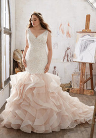 Mori Lee 3216.  Frosted Alenon Lace Appliqus Adorn the Figure Flattering Bodice on this Beautiful Mermaid Wedding Dress. A Flounced Organza Skirt Accented with Horsehair Trim Completes the Stunning Look. Colors Available: White, Ivory, Ivory/Champagne. Shown in Ivory/Champagne.