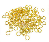 100 5mm gold Plated closed jump rings