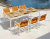 ALLUX dining table with abstract slats and ALLUX dining armchairs