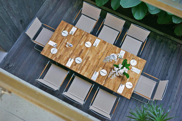 "NATUN Slat Table 88.5"" x 39.5"" (teak) with NATUN Stacking Chairs (hemp)"