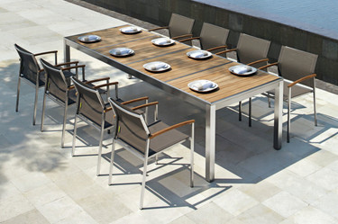"""ZIX Dining Table 106.5"""" x 39.5"""" with ZIX Stacking Armchairs - Stainless Steel (hairline finish), Plantation Teak (smooth sanded, abstract pattern slats)"""