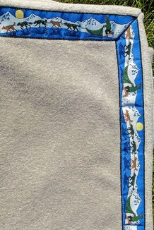 BLANKET - 5' x 5'  / (Double-Sided Thermal Fleece) /  Frosted Taupe, / Race Is On-Green (trim)