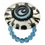 "Enjoy the ease and whimsy of this ""Genesis"" stretch ring from the Ocean Tales collection.  Stretch band with blue beads that contrast with the blue center on top the ring offset with white background and black abstract designs."