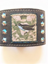 "Soft brown leather 2"" cuff bracelet with two dual adjustable snap fasteners for 7"" or 7.5"" sizing L514 Royal Robin artwork stamped on leather & sewn to bracelet leather  Four aurora borealis iridescent Swarovski crystals on each side of robin artwork Handmade in Los Angeles by KBD Design"