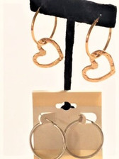 Non-tarnish textured gold finish heart cutout embellishes these gold hoop earrings to elevate hoop wearing with style.  Also comes with second pair of non-tarnish silver hoops where you can mix metal types by wearing silver hoops with the gold heart cutouts.  Heart cutout can be removed to wear hoops alone.