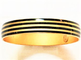 From the Enamel collection Antiqued gold plated finish over a copper base metal Bangle width is .50 (half inch) Striped pattern Pairs well with other gold toned bangle bracelets By La Vie Parisienne