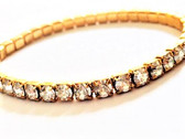 From the Antiqued Gold Plated collection 14K gold finish over a copper base metal Stretch bracelet is .18 inch wide Shade colored Swarovski crystals around entire bracelet Comfortable fitting; value for price; complementary layered with other bracelets By La Vie Parisienne