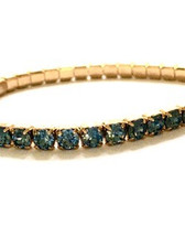 From the Antiqued Gold Plated collection 14K gold finish over a copper base metal Stretch bracelet is .18 inch wide Blue shade colored Swarovski crystals around entire bracelet Comfortable fitting; value for price; complementary layered with other bracelets By La Vie Parisienne