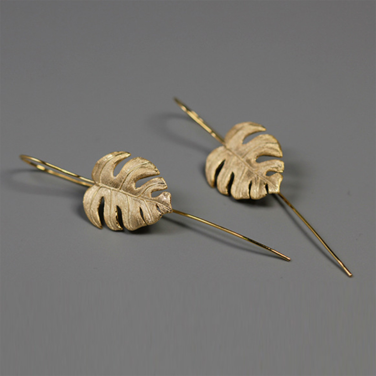 5e949e2cc ... Monstera Deliciosa Leaf Earrings.  Botanic_garden_collection_sterling_silver_gold_plating_monstera_deliciosa_leaf_earrings_handmade.  Loading zoom