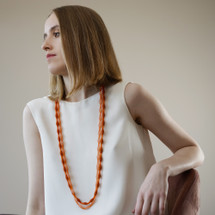 Tzuri_Gueta_handmade_jewellery_necklace_long_silicone_viscose_organic_looking_orange_transparent_Paris_France_statement_bright_eye_catching