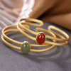 Amira_S_handmade_jewellery_bracelet_bangle_cut_out_design_sterling_silver_gold_plating_jade_stone_red_agate_stone