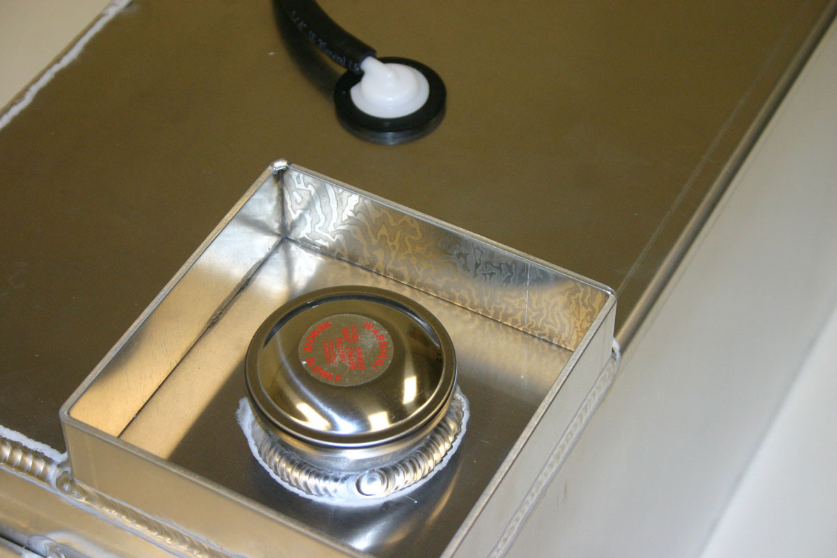 "Close up view of gas cap and ""dam"" to prevent damage or spillage"